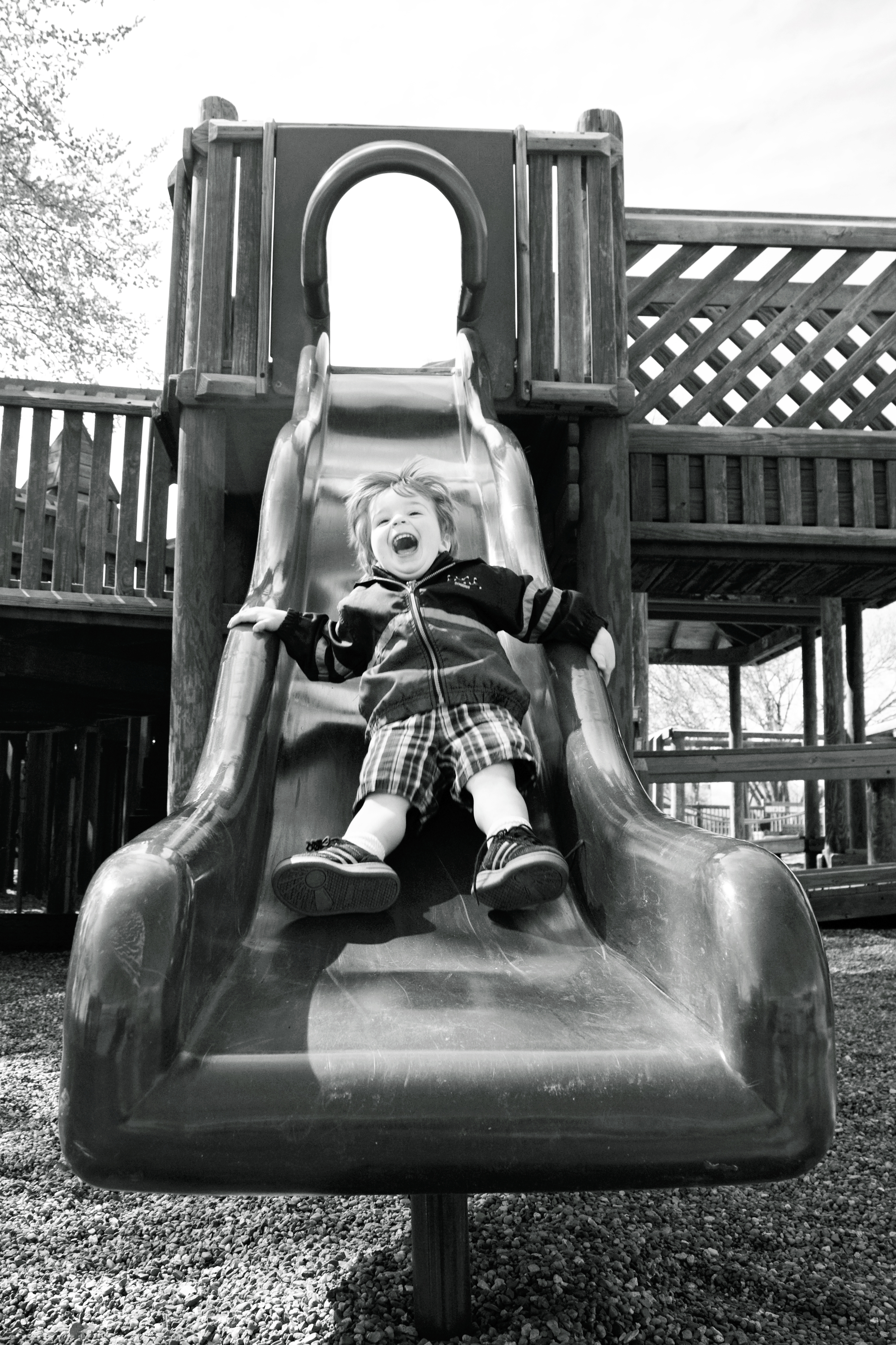 Kid going down slide